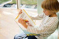 Boy reading a book, Side View, High Angle View, Differential Focus