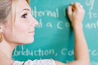 College Girl Writing on Blackboard, Selective Focus