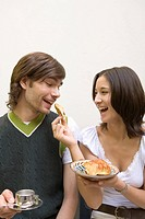 Image of a Young Adult Couple, the Woman Feeding Some Bread to the Man, Smiling, Side View, France
