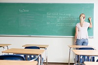 College Girl Writing on Blackboard