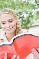 College Girl Reading Book Outside