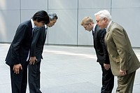 Businessmen Bowing