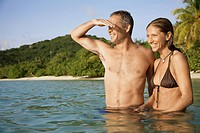 Mid adult couple standing in water and looking at view, St. John, US Virgin Islands, USA