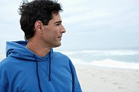 Mid adult man looking at view on beach
