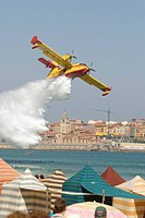 Canadair waterbomber during airshow at Gijón beach, Spain