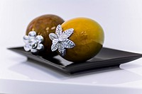 Close_up of artificial fruits in a tray