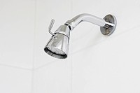 Close_up of a shower head in the bathroom
