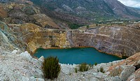 Water filled shaft and slag heaps of copper mines in Queenstown Tasmania Australia