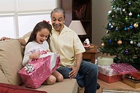 Grandfather and granddaughter with Christmas gifts