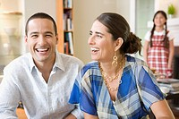 Couple laughing at home
