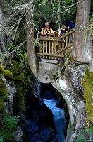 Tourists are standing on a platform above a deep gorge near Pont de la Tena Haute-Savoie France
