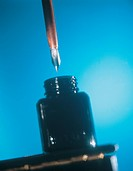 Close_up of a pen staining with ink