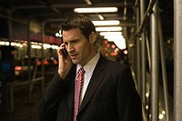 Businessman using a cellular telephone (thumbnail)