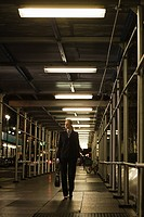 Businessman walking on sidewalk (thumbnail)