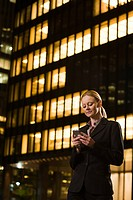 Businesswoman text messaging