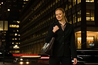 Businesswoman at night