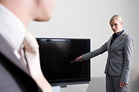 Businesswoman with television