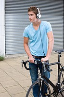 Cyclist wearing headphones