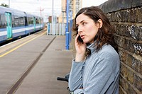 Woman on cellphone at train station