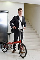 Man in office with bike