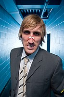 Hostile businessman with a broken nose (thumbnail)