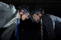 Businessmen playing ice hockey
