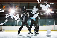 Two businessmen fighting on the ice
