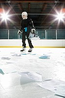 Businessman and documents on an ice rink