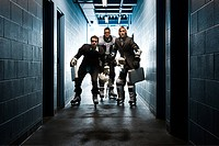 Three businessmen wearing ice hockey uniforms