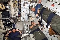 Space Shuttle astronauts sleeping. These three astronauts are part of the crew of the Space Shuttle Discovery, flying mission STS_120 to the Internati...