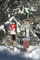 Sign post at the cross-country ski run between Winkelmoosalm Upper Bavaria Germany and Heutal Salzburger Land Austria