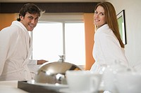 Smiling couple wearing bathrobes (thumbnail)