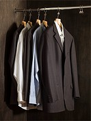 Suits hanging in a closet