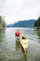 Woman kayaking in fjord