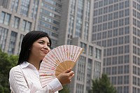 Chinese woman with a handfan