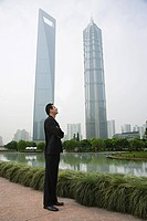 Businessman standing near skyscrapers