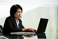 Chinese businesswoman at work