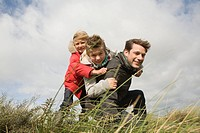 Children and father outdoors