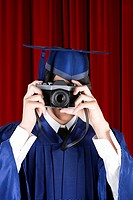 Graduating boy with camera