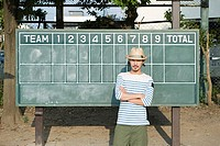 Young man by scoreboard (thumbnail)
