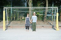 Young couple in football goal