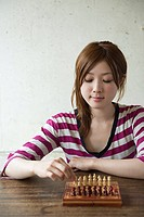 Young woman playing chess