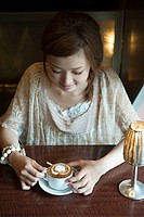 Young woman having coffee