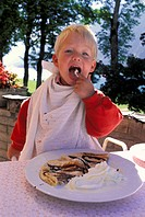 Two-year-old eating cream - Aachensee - Tirol - Austria MR
