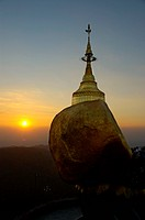 Golden Rock with stupa and sundown Kyaikhtiyo Pagoda Bago Burma