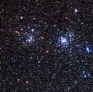 Perseus double cluster. True_colour optical image of the Perseus double star cluster. These open star clusters, Chi Persei NGC 884, centre left and h ...