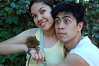 Couples have fun with a tarsier, Bohol, Philippines