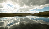 Storm clouds reflected in a dam on a Natal Midlands Farm. KwaZulu Natal Province, South Africa