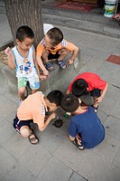 Children playing on the street, Shuyuan antique avenue, Xian, China