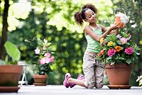 Girl Watering Potted Plant